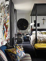 A Zulu skirt is one of many interesting objects decorating the walls of the master bedroom
