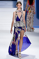 Lara Mullen walks runway in an indigo psychedelic printed silk chiffon high-low gown with plunging V-cutout and indigo stretch cotton peplum belt.by Vera Wang, for the Vera Wang Spring 2012 collection, during Mercedes-Benz Fashion Week Spring 2012.