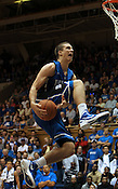 Freshman Marshell Plumlee adds style to his dunk during the dunk contest. Photo by Al Drago...