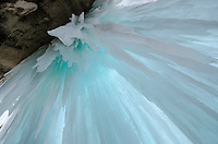 Looking up at the colorful ice pillars of the Grand Island ice caves. Munising, MI