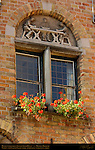 Huidevettershuis Tanner's Guild House 1450, Window and Lunette Detail, Apprentices working a Hide, Huidenvettersplein Tanner's Square, Bruges, Brugge, Belgium