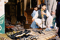 Newly made Pakistani Kalashnikovs and gun's in a Darra shop. Darra town in Pakistan clandestinely provides arms to more than eight Central Asian countries.