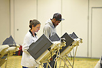 Andre Walker (left) and Bobby Hudgens vote  at the Oxford Conference Center in Oxford, Miss. on Tuesday, November 6, 2012.