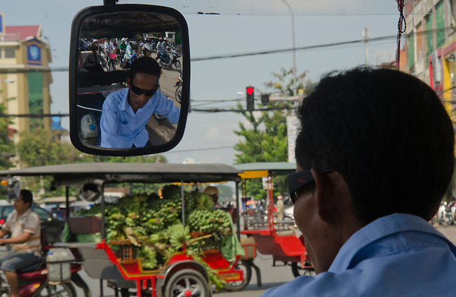 Tuk-tuk with goods for sale