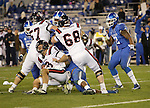 Samford Bulldogs quarterback Andy Summerlin (8) gets tackled during the second half of the UK Football game v. Samford at Commonwealth Stadium in Lexington, Ky., on Saturday, November 17, 2012. Photo by Genevieve Adams | Staff