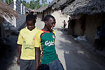 PEMBA, TANZANIA - DECEMBER 7 : Hamissi Usi, age 15, with his best friend outside his home on December 7, 2010 on Pemba, Tanzania. He works as a fisherman. He doesn't go to school but lives with his parents and siblings in the small village of Tumbe. (Photo by: Per-Anders Pettersson For Stern Magazine)