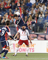 New England Revolution midfielder Ryan Guy (13) goes high for a head ball. Despite a red-card man advantage, in a Major League Soccer (MLS) match, the New England Revolution tied New York Red Bulls, 1-1, at Gillette Stadium on September 22, 2012.