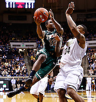 WEST LAFAYETTE, IN - DECEMBER 29: Brandon Britt #12 of the William &amp; Mary Tribe shoots the ball against Jacob Lawson #34 of the Purdue Boilermakers at Mackey Arena on December 29, 2012 in West Lafayette, Indiana. Purdue defeated William &amp; Mary 73-66. (Photo by Michael Hickey/Getty Images) *** Local Caption *** Brandon Britt; Jacob Lawson