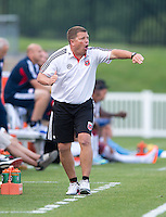 D.C. United coach Chad Ashton yells to his team during the quarterfinals of the US Open Cup at the Maryland SoccerPlex in Boyds, Md.  D.C. United defeated the New England Revolution, 3-1.