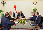 Egyptian President Abdel Fattah al-Sisi meets with Prime Minister Sharif Ismail, in Cairo, Egypt, on May 22, 2017. Photo by Egyptian President Office