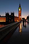 Big Ben reflected in Westminster Bridge after rain at sunset.