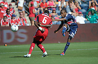 New York midfielder Dane Richards (19) shoots around Chicago defender Jalil Anibaba (6).  The Chicago Fire defeated the New York Red Bulls 3-1 at Toyota Park in Bridgeview, IL on June 17, 2012.