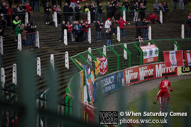Glentoran 2 Cliftonville 1, 22/10/2016. The Oval, NIFL Premiership. Away supporters and players celebrating their team's opening goal during the first-half action at The Oval, Belfast as Glentoran (in green) host city-rivals Cliftonville in an NIFL Premiership match. Glentoran, formed in 1892, have been based at The Oval since their formation and are historically one of Northern Ireland's 'big two' football clubs. They had an unprecendentally bad start to the 2016-17 league campaign, but came from behind to win this fixture 2-1, watched by a crowd of 1872. Photo by Colin McPherson.