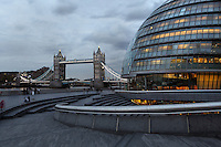 City Hall, Foster & Partners, 2002, Southbank, River Thames, London, UK, and Tower Bridge, 1886-94, in the background and guardrail of the Scoop Arena in the foreground. Nicknamed the London Egg, the 45m high City Hall is the headquarters of the Greater London Authority. Its glass and steel structure incorporates environmentally friendly features such as solar panels. Picture by Manuel Cohen