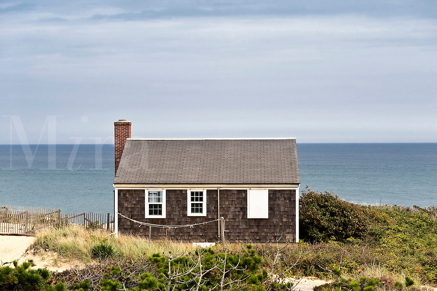 Small Cape Cod cottage overlooking the ocean, Wellfleet, Cape Cod, MA: miraimages.photoshelter.com/image/i0000i6hrwkpdrpg