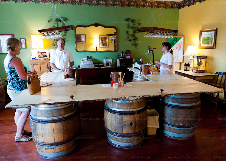 The unusual bar in the tasting room at General's Ridge Vineyard and Winery is made from antique original doors of the manor house on the property, supported by old wine barrels.