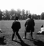 Eton boy watching cricket at Eton Fourth of June