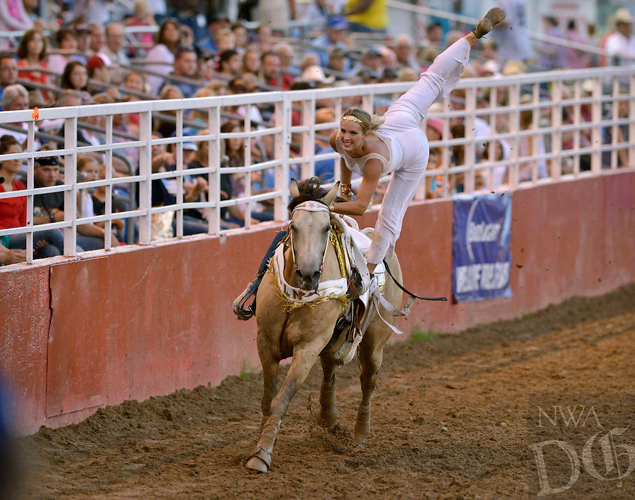 NWA Democrat-Gazette/BEN GOFF &bull; @NWABENGOFF<br /> Lindy Nealy of The Cowgirl Sweethearts trick riders on Friday July 3, 2015 during the Rodeo of The Ozarks at Parsons Stadium in Springdale.