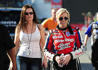 Feb. 9, 2012; Pomona, CA, USA; NHRA funny car driver Courtney Force (right) with mother Laurie Force during qualifying at the Winternationals at Auto Club Raceway at Pomona. Mandatory Credit: Mark J. Rebilas-