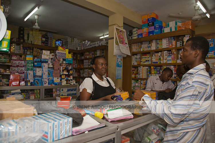 A man buys health products from a pharmaceutical wholesaler in the Wuse II neighborhood of Abuja, Nigeria.