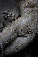 Detail of a female sculpture, Fontana Diana, Giulio Moschetti, 1906, on Piazza Archimede in Ortigia, Syracuse, Sicily, pictured on September 13, 2009, in the morning. The Diana Fountain is the centre of the Piazza Archimede in Ortigia, the historic centre of Syracuse. It tells the mythological story of Diana transforming the nymph Arethusa into a spring on a site in Ortigia. Ortigia is one of the names associated with the goddess Artemis, the Romans identified her as Diana. The Piazza is named after the ingenious greek mathematician and philosopher Archimede who died defending Syracuse against the Romans. Today the city is a UNESCO World Heritage Site. Picture by Manuel Cohen.