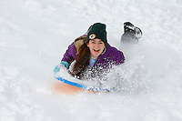 Grace Walner sleds down Olbrich Park hill after the winter snowstorm on Sunday in Madison