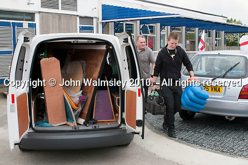 Students from Rose Bruford College unload the van before performing at a state Infant School.