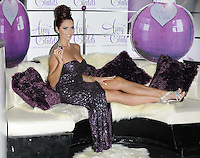Amy Childs.The photocall to launch her debut fragrance in collaboration with Jigsaw, Aura bar & nightclub, London, England..August 15th, 2012.full length purple strapless dress slit split sequins sequined hair up bun sofa couch sitting silver sandals shoes  .CAP/CAN.©Can Nguyen/Capital Pictures.