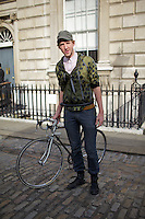Christopher Raeburn and his bicycle