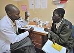 At the Presbyterian Church-sponsored Ekwendeni Hospital in northern Malawi, a patient receives counseling before receiving anti-retroviral medications for HIV infection.