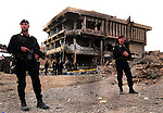Italian carabinieri stand guard November 15, 2003 at the site of the Nov 12, 2003 suicide car bomb attack on the barracks of the Italian carabinieri in Nasiriyah, Iraq. The attack killed more than 26, including 16 Italian soldiers and 2 civilians.