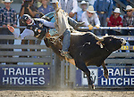 Shane Gordon from Fort Jones, CA., tries to hang onto Slam Dunk during the Xtreme Bull Riding Competition at the Kitsap County Fair and Stampede  held Aug. 26 to Aug. 30, 2009 in Silverdale, WA. Jim Bryant Photo. All Right Reserved. © 2009