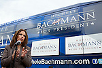 Republican presidential hopeful Michele Bachmann talks to reporters after a campaign stop on Saturday, July 23, 2011 in Marshalltown, IA.