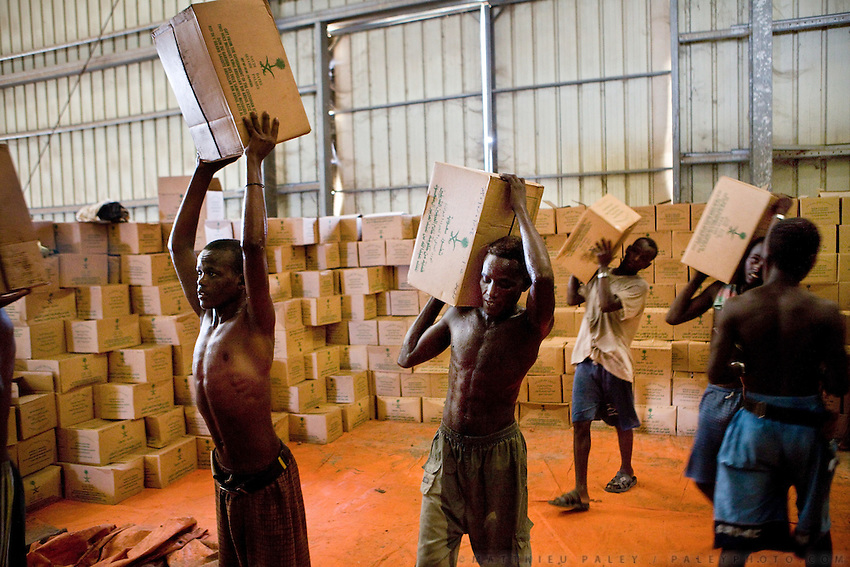 At the Dry Port, young malnourished daily workers loading cartons of Dates, sent by the UN's World Food Programme, to fight famine in Ethiopia. Djibouti is one of the biggest transhipment points in the world for the UN...The geostrategical and geopolitical importance of the Republic of Djibouti, located on the Horn of Africa, by the Red Sea and the Gulf of Aden, and bordered by Eritrea, Ethiopia and Somalia.