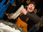 Jim Urquhart/Straylighteffect.com Fish monger Chris Bell throws a fish at the Pike Place Fish Market at the Pike Place Market in Seattle, Washington. 12/22/2009 - Jim Urquhart/Straylighteffect.com