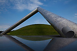 &quot;Tetra Mound&quot; by Isamu Noguchi installed at Moerenuma Park in Sapporo.  The installation was designed by Noguchi a Japanese-Amerian artist and architect. Construction of the park was begun in 1988, and opened in 2005. The park has won a number of awards including the Good Design Award in 2002.  The park is considered to be one complete sculpture. The triangular sculpture over a grassy mound is called &quot;Tetra Mound&quot;.