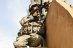 Pfc. Joseph Cerchiaro, 23, of Sterling, N.J., takes a defensive position at the top of a staircase in an apartment block in Samarra, Iraq. Soldiers with Company C,  2nd Battalion, 327th Infantry Regiment questioned residents about a series of bomb attacks that have taken place against them in recent weeks. Nov. 17, 2007. DREW BROWN/STARS AND STRIPES