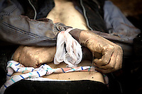 The tied hands of a dead man found in a mass grave in the grounds of a school in the eastern Damascus suburb of Sakba. Locals say they were unable to bury the dead killed during an assault by government forces in an attempt to take the area back from the Free Syrian Army.Protests against the ruling Baathist regime of Bashar al-Assad erupted in March 2011. Although they were initially peaceful,  they were violently repressed by the Syrian army and police. In response to being ordered to shoot unarmed civilians, large numbers of men deserted the army and formed the Free Syrian Army. The protest movement has now turned into an armed uprising with clashes between the regular army and the Free Syrian Army taking place in early 2012....