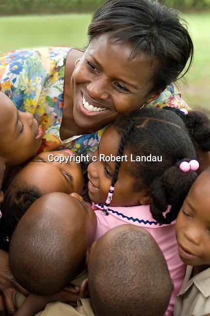 Deborah Roberts gets a hug from school children as she departs Jamaica.