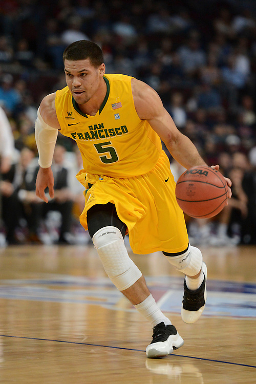 March 10, 2014; Las Vegas, NV, USA; San Francisco Dons guard Matt Glover (5) dribbles against the Brigham Young Cougars during the first half of the WCC Basketball Championships at Orleans Arena.