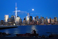 People watch together the full moon as it rises over New York City from a park in New Jersey. March 15, 2014. Photo by Eduardo Munoz Alvarez/VIEW