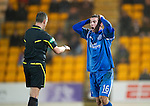 St Johnstone v Partick Thistle....09.02.11  Scottish Cup 5th Round.Peter MacDonald can't believe it as he is booked by ref Iain Brines for diving.Picture by Graeme Hart..Copyright Perthshire Picture Agency.Tel: 01738 623350  Mobile: 07990 594431