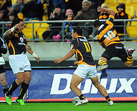 Wellington's Ma'a Nonu celebrates Alapati Leiua's try as Willie Ripia disappears over the advertising. ITM Cup rugby union - Wellington Lions v Taranaki at Westpac Stadium, Wellington, New Zealand on Saturday, 16 October 2010. Photo: Dave Lintott / lintottphoto.co.nz