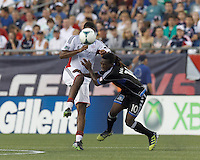 New England Revolution defender Andrew Farrell (2) heads the ball. San Jose Earthquakes midfielder Walter Martinez (10) takes out Andrew Farrell and earns a yellow card. In a Major League Soccer (MLS) match, the New England Revolution (white) defeated San Jose Earthquakes (black), 2-0, at Gillette Stadium on July 6, 2013.