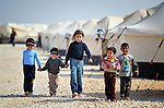 Children walking in the Zaatari Refugee Camp, located near Mafraq, Jordan. Opened in July, 2012, the camp holds upwards of 50,000 refugees from the civil war inside Syria. International Orthodox Christian Charities and other members of the ACT Alliance are active in the camp providing essential items and services.