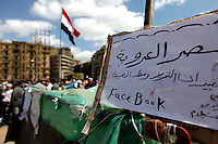 Tent with reference to Facebook in Tahrir square, after the revolution that saw president Hosni Mubarak ousted from office. Some protesters still occupied the Tahrir Square until March 9, when they were chased away by armed men,  while life in other parts of the city returned to normal.