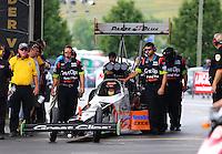 Jun 21, 2015; Bristol, TN, USA; Crew members wait with NHRA top fuel driver Clay Millican during the Thunder Valley Nationals at Bristol Dragway. Mandatory Credit: Mark J. Rebilas-