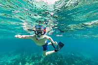 Snorkeling at Laughing Brid Caye National Park, is a small isle 11 miles off the coast of Belize
