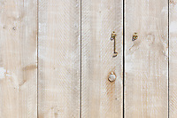 detail of a wooden door made of scaffolding