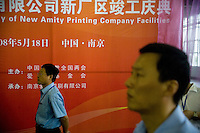 "Amity Printing Company employees watch the inauguration ceremony for the opening of the Amity Printing Company's new printing facility in Nanjing, China....On May 18, 2008, the Amity Printing Company in Nanjing, Jiangsu Province, China, inaugurated its new printing facility in southern Nanjing.  The facility doubles the printing capacity of the company, now up to 12 million Bibles produced in a year, making Amity Printing Company the largest producer of Bibles in the world.  The company, in cooperation with the international organization the United Bible Societies, produces Bibles for both domestic Chinese use and international distribution.  The company's Bibles are printed in Chinese and many other languages.  Within China, the Bibles are distributed both to registered and unregistered Christians who worship in illegal ""house churches."""